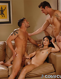 Guys fooling with a chick