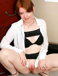 Cute redhead lady strips nude