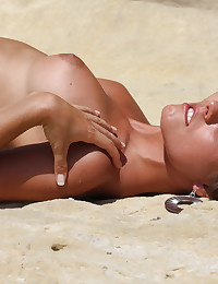 Sun Erotica's Ashley Bulgari gets wild in the beach in these free photos.