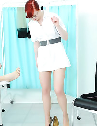 Redhead in lingerie strokes c...