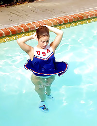 Cheerleader takes a swim