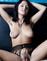Mirelle A shows off her hot body in this photo set by Met Art.