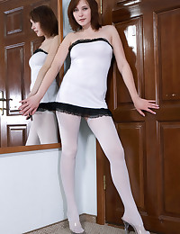 The girl looks virginal in her white stockings and panties.