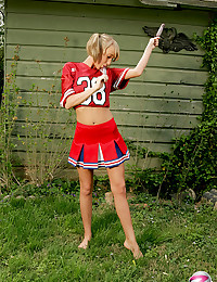Cheerleader girl tease outdoors