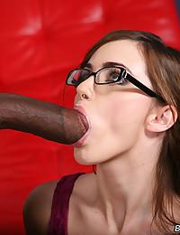 Gorgeous girl in glasses goes black