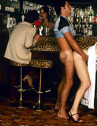 Seventies girl gets a free cocktail in a bar