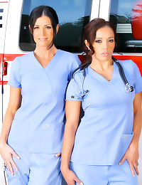Clothed doctor ladies in ambu...