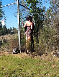 Girl fucked against fence in ...