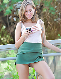Cute teen flashes outdoors