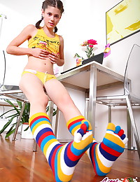 Little Caprice - Slim leggy girl in striped gaiters lets you scrutinize her fresh body