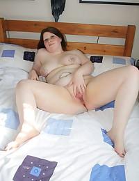 Tattooed BBW solo striptease