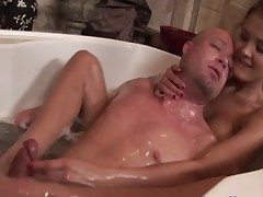 Brunette foot wanks her clients cock