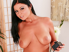Christina's big tits bounce as she ride her pussy on the toy