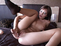 Nikita's perfect little ass gets fucked with a glass sex toy