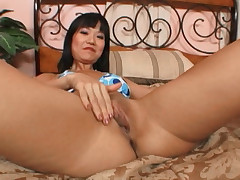 Asian girl with nice tits is simply drooling to suck a cock!