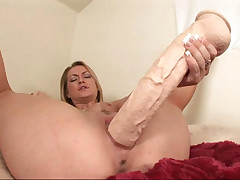 Slutty gal love big toys and fuck her tight pussy with them