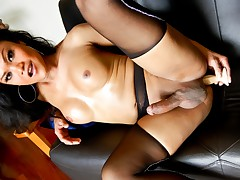 Tranny looks amazing and she really likes touching herself!