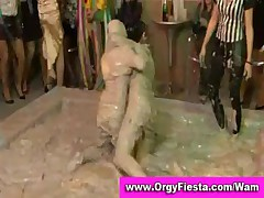 Fully clothed wam chicks have mudwrestling contest