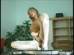 Nasty nylon babe toying pussy