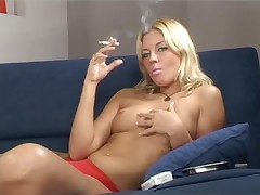 Tanya smoking and showing her tits