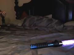 Hot geek masturbating with lightsaber dildo