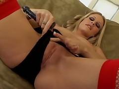 Skinny blonde in stockings toy fucks her box