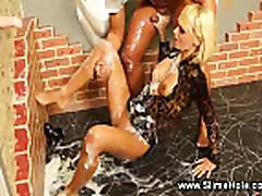 Blonde masturbates while gloryhole sprays her