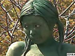 Mosaic; A living nude female Japanese garden statue