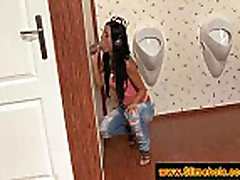 Gorgeous brunette sucking at a gloryhole